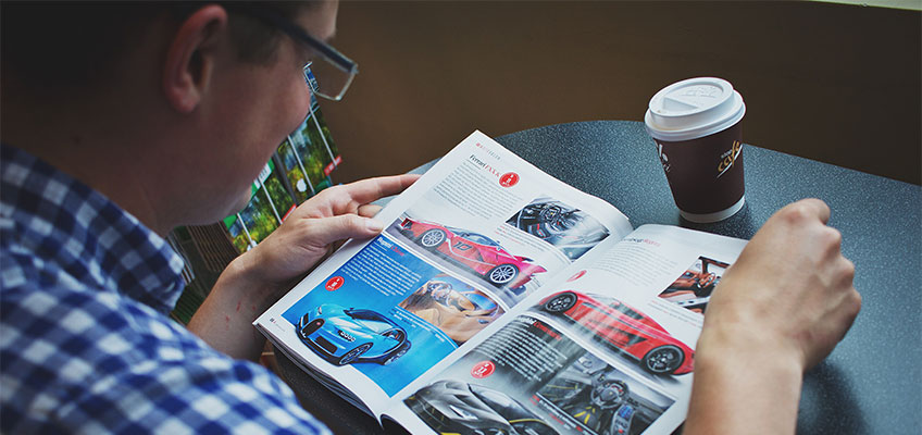 Image of a person reading magazine, Printing in Los Angeles, Perfect Image Printing