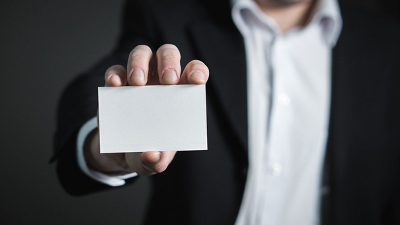 Image of a person holding a business card, Blog, Perfect Image Printers